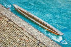 Old Wooden Boat. Moored to Jetty at Limmat river in Zurich, Switzerland Stock Photo