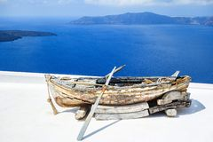 The old wooden boat with oars Stock Photos