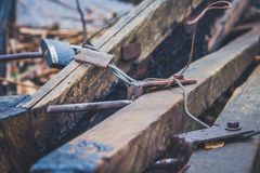 An old wooden boat with oars, rope and other gear. Closed oars.  Royalty Free Stock Photos
