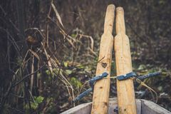 An old wooden boat with oars, rope and other gear. Closed oars.  Royalty Free Stock Photography