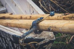 An old wooden boat with oars, rope and other gear. Closed oars.  Stock Photos