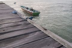 Old wooden boat on a pier stock photo