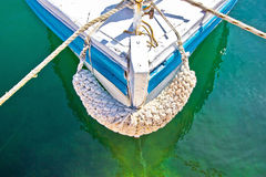 Old Wooden Boat Prow In Green Water Stock Photo