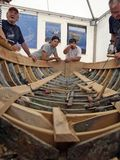 An old wooden boat restoration. Brest, France - July 16, 2008: Croatian traditional shipbuilders are working on the restoration of an old wooden boat during the Royalty Free Stock Image