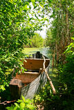 Old wooden boat at the river bank. Royalty Free Stock Image