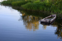 Old wooden boat by the river Stock Photos
