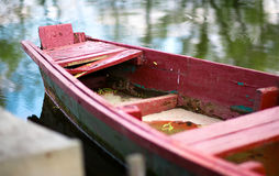 The old wooden boat on the river Stock Images