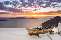 Old wooden boat on roof in Firostefani, Santorini island, Greece Stock Photo