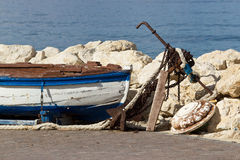 Old wooden boat and rusty anchor Stock Photo