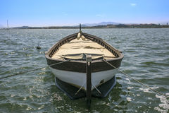 Old wooden boat on the sea Stock Photo
