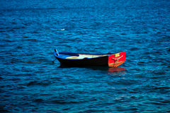 Old wooden boat in sea Royalty Free Stock Photo