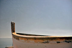 Old wooden boat at the sea. With the nice morning light Royalty Free Stock Photos
