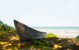Old wooden boat on the seashore Stock Photo