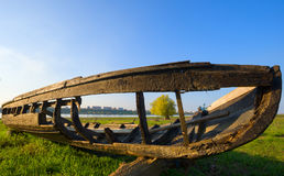 Old wooden boat on shore. Antic boat near the lake Stock Photography