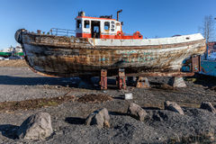 Old wooden boat on shore Stock Photography