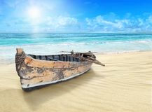 Old, wooden boat on the shore. Royalty Free Stock Image