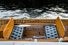 Old wooden boat - sitting section. Interior mid section of a vintage wooden Disappearing Propeller boat Royalty Free Stock Photos
