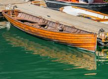 Old Wooden Boat Tied to Dock Stock Photography