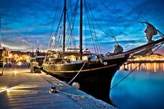 Old wooden boat in Vodice harbor. Night view, Dalmatia, Croatia Stock Images