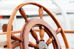Old wooden boat wheel. The helm of a schooner stock photos