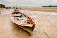 Old wooden boat wreck on the beach Royalty Free Stock Photo