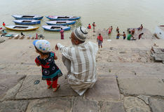 Old wooden boats on the bank of Ganges Stock Photos