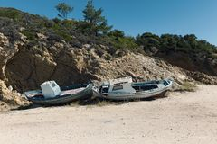 Old wooden boats. Drawn to the coast Royalty Free Stock Image