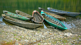 Old wooden boats moored to the bank of the river Royalty Free Stock Photography