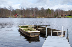Old wooden boats. Two wooden boats on Swedish lake Stock Images