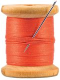 Old wooden bobbin with red thread isolated Stock Photography