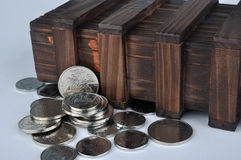 Old wooden box and coins. Old wooden box with metal coin in it, means money keeping, saving, money protection, and moeny safety stock photos
