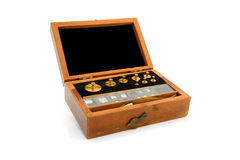 Old wooden box with copper weights Stock Image