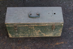 Old wooden box with cracked paint. Old wooden box for ammunition with cracked paint Stock Photo