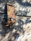 Old wooden box with rusty padlock royalty free stock photography