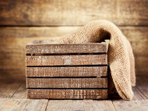 Old wooden box with sack Royalty Free Stock Image