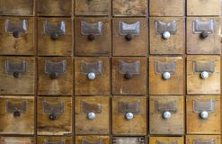 Old wooden boxes for forms. Old archive or library. stock image