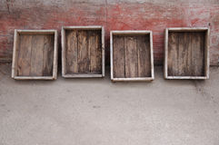 Old wooden boxes at a patina wall Stock Photo