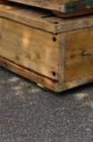 Old wooden boxes with rope handles on street Stock Photography