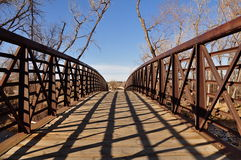 Old Wooden Bridge. An old wooden bridge extends out into the distance on a cold winter day in Colorado Stock Photos