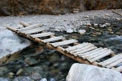 Old wooden bridge. Over flowing stream stock photo
