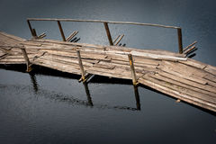 Old wooden bridge above the river Stock Photo