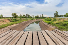 Old wooden bridge across  canal. Old wooden bridge across the canal Stock Photo