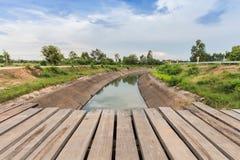 Old wooden bridge across  canal Stock Photo
