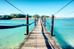 Old wooden bridge across the lagoon Royalty Free Stock Image