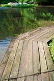 Old wooden bridge along the lake Stock Photos
