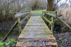 Wooden bridge on park. Old wooden bridge in autumn park Stock Image