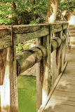 Old wooden bridge. In a beautiful garden, springtime Stock Photo