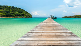 Old wooden bridge with beautiful turquoise sea Stock Photos