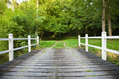 Old Wooden bridge in the forest stock photos
