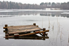 Old wooden bridge on a frozen lake Royalty Free Stock Photo